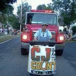 Tradio Trevor swappin' your post parade trash for CJ Tune In Cards at the 2012 Warsaw Fireman's Carnival Parade!