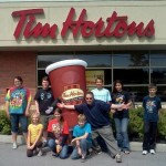 Tim Horton's Camp Day... Every penny of every cup of coffee you purchased that day at Tim Horton's went to send kids to camp- Here's CJ Morning Dude Trevor Carey and some happy campers!!