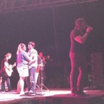 "Jerrod sings ""Only God Could Love You More"" while a couple dances on stage"